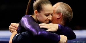 PHILADELPHIA - JUNE 22:  Chellsie Memmel gets a hug from her coach and father Andy Memmel after competing on the balance beam during day four of the 2008 U.S. Olympic Team Trials for gymnastics at the Wachovia Center on June 22, 2008 in Philadelphia, Pennsylvania.  (Photo by Al Bello/Getty Images)